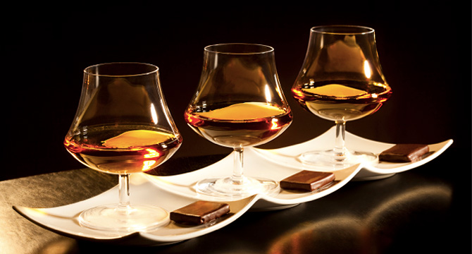 whiskey glasses with piece of chocolate
